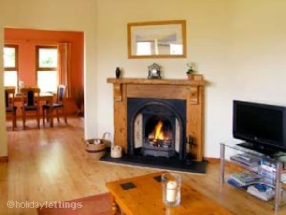 Fireplace with coal fire, 3 & 2 seater settees