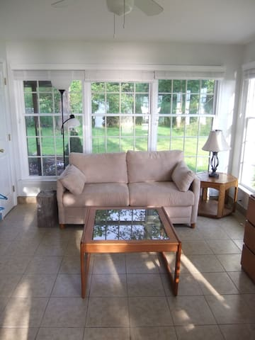 Sunroom doubles as second bedroom.  Some of the best water views are enjoyed from the Sunroom.    Sunroom features a dedicated heating/cooling mini-split HVAC system.