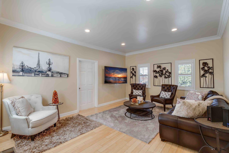 Beautiful huge living room. Plenty of sitting space. Beautiful wood shutters.
