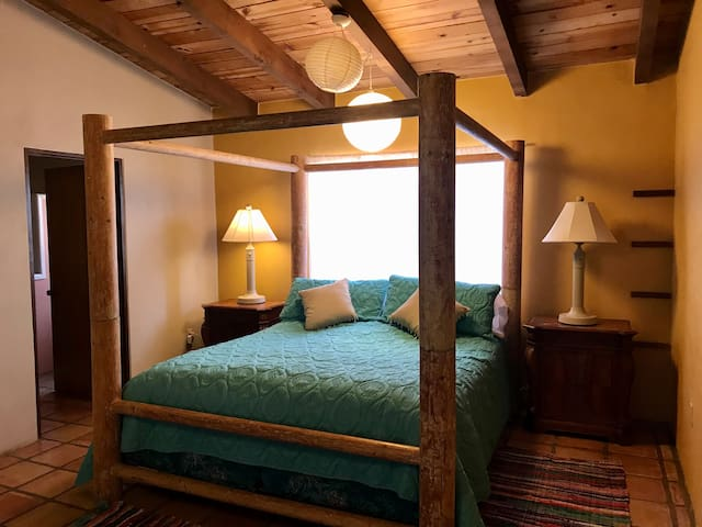 The huge master bedroom features this dramatic Cal-King bed, as well as a set of bunkbeds, attached bathroom, and large walk-in closet.