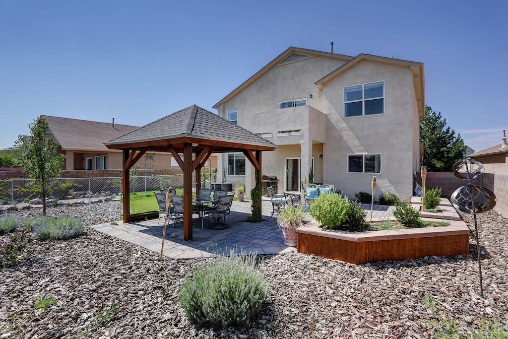Backyard space with gazebo, fire pit and Traeger barbecue grill