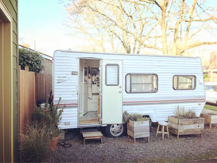 Refurbished vintage trailer in cozy neighborhood.