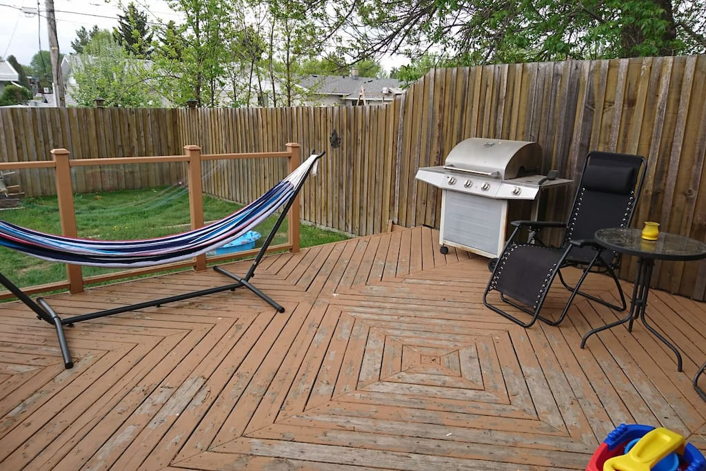 Back deck with bbq and sitting area (shared space)