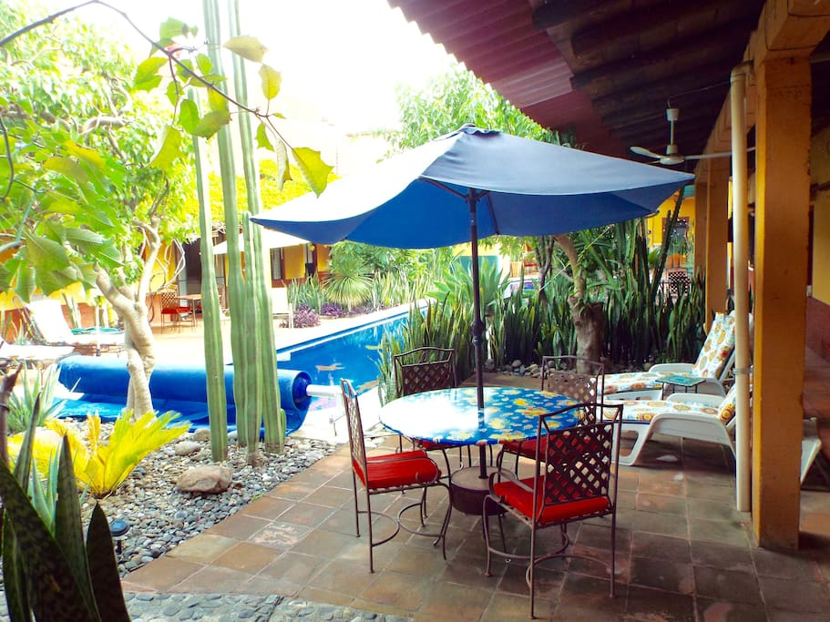 Private poolside patio has table, 4 chairs and two chaise lounges. Gets morning sun.
