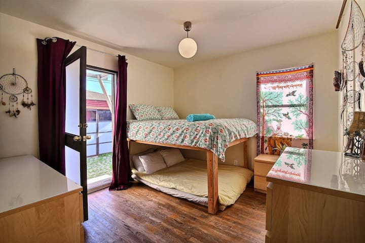 Lots of space to sleep in two Queen size beds inside the Main House with an extra entrance on the side and an attached bathroom with bathtub