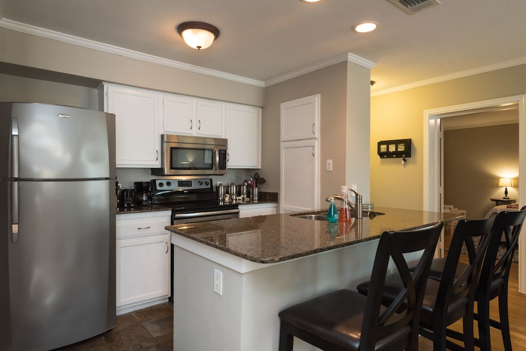 Kitchen opens to living/dining