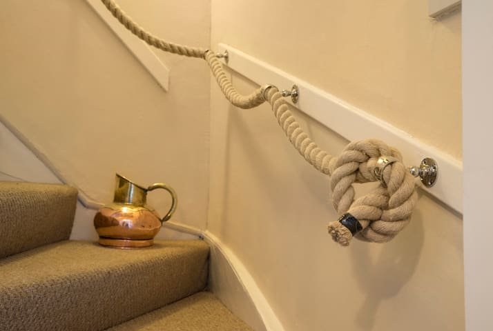 A rope banister leads you to the attic bedroom.