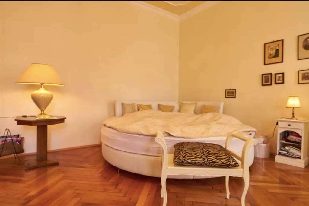 Large round king size bed in the bedroom. .