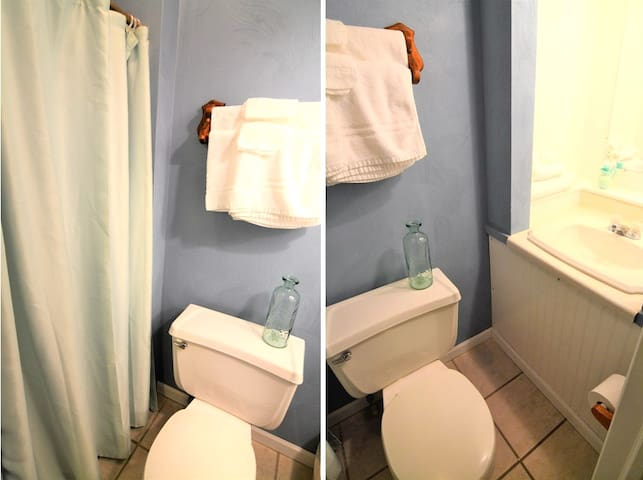 The compact bathroom is comparable to a cruise ship style bathroom.