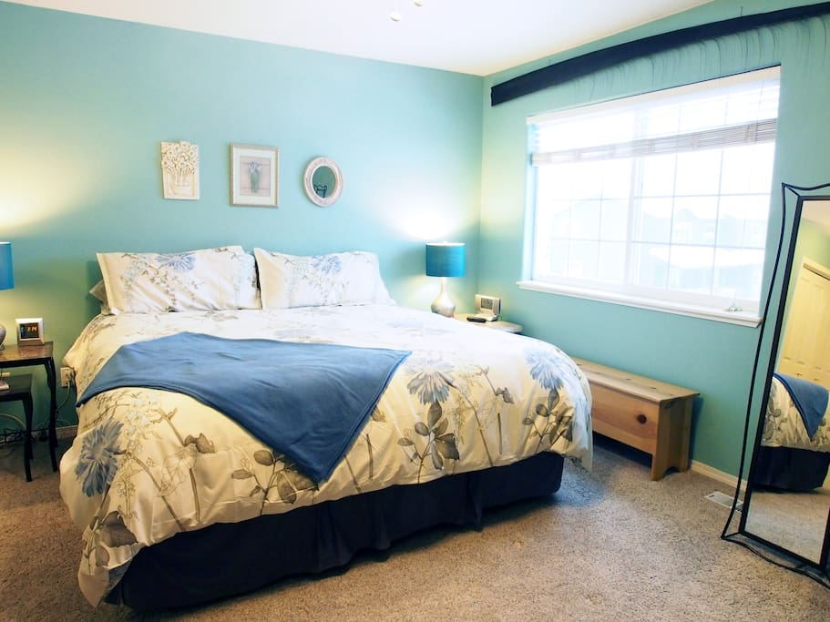 The beautiful master bedroom is filled with natural light and plenty of space.