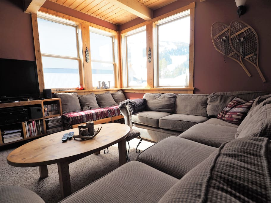 The large sectional couch can be hard to leave with the amazing views and warm wood fire place