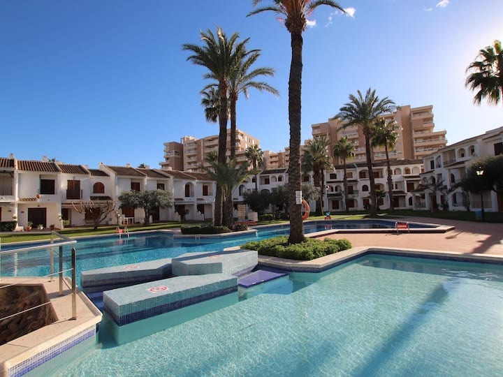Apartment with community pool 50 meters from the sea.