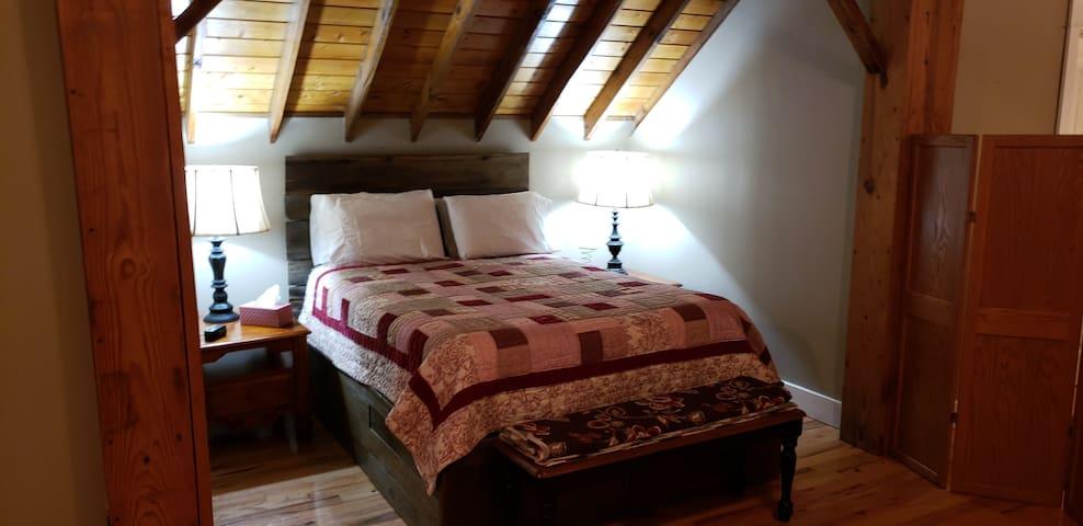 Queen Bed in upstairs sleeping quarters.