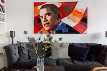 The painting is a work of art by swedish artist Catrine Näsmark. It's actually a mix of paint, textiles and materials.  This photo is taken by an official Airbnb professional photographer.
