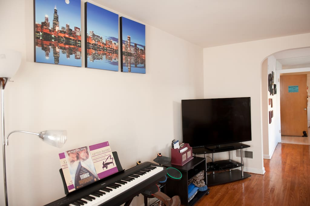"""The living room also features a 60"""" TV and great photos of the Chicago skyline."""