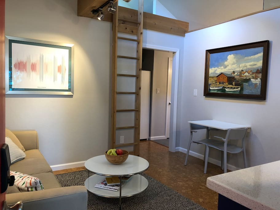 The living space is perfect for two with art spanning the centuries and countries. The piece on the left is from San Francisco and the one on the right is from Denmark.