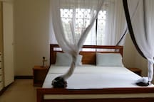 King-sized bed with mosquito net