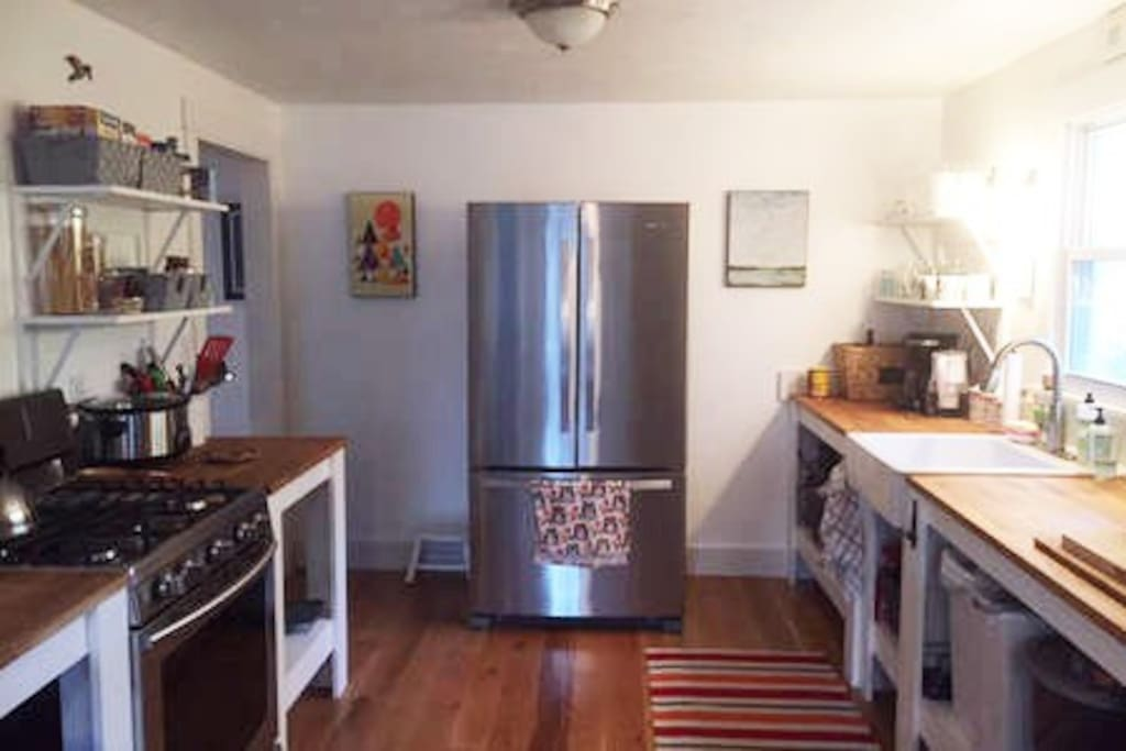 Kitchen w/plenty of counter space, full size fridge, gas stove, microwave, toaster.