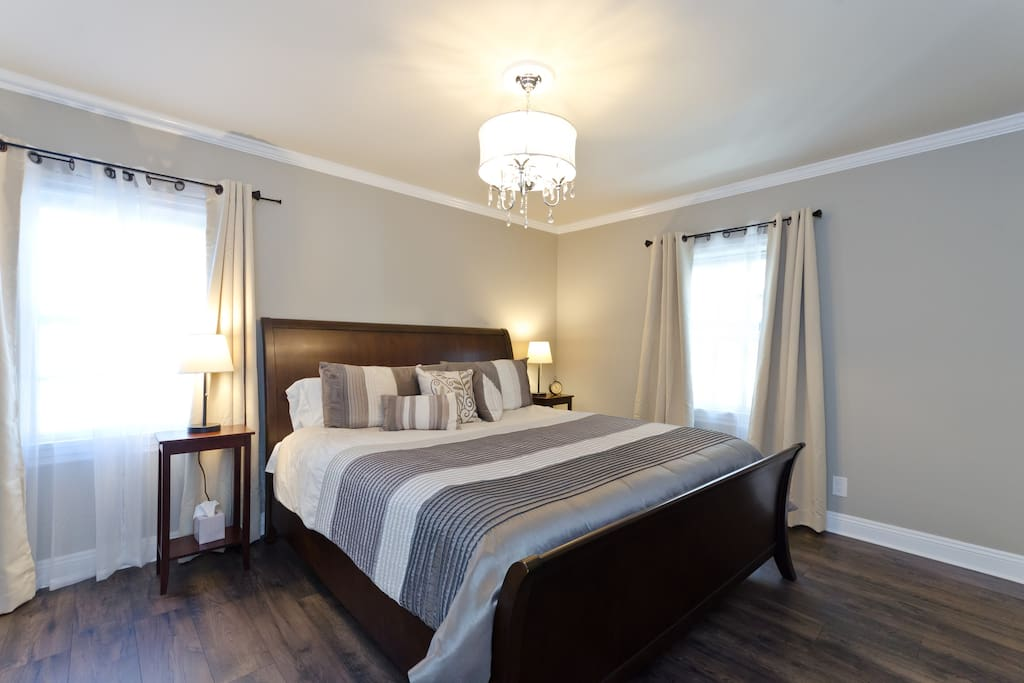 Bedroom 1 has a King-size Sterns & Foster mattress sleigh bed with high-thread count hotel quality sheets.