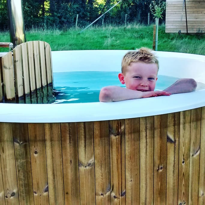 Each of our lodges has a wood fired hot tub
