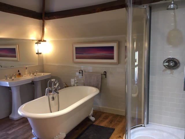 Large beautiful bathroom with bath and separate shower.