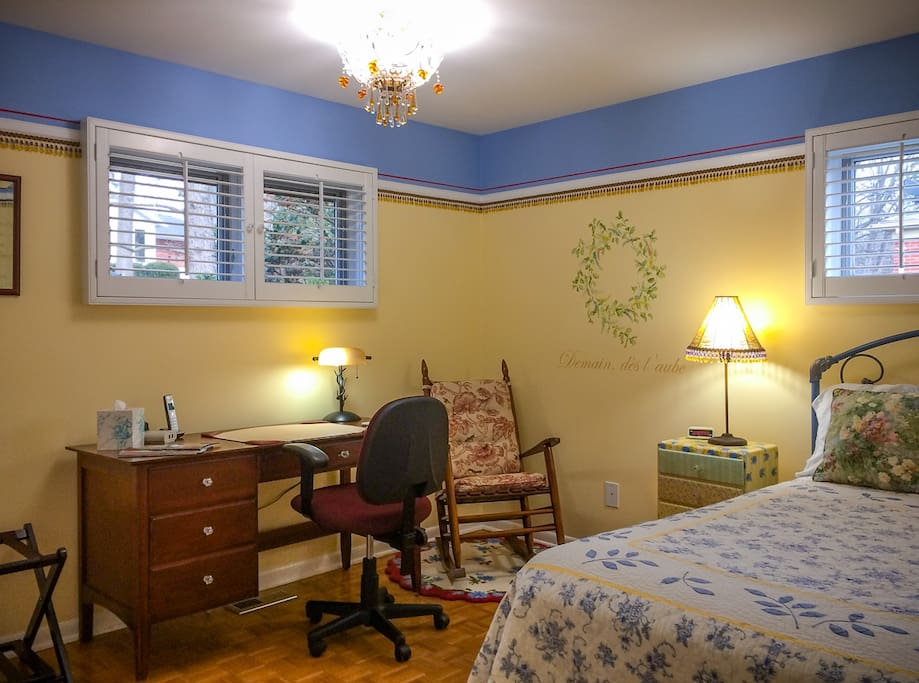 The Poetry Room. A quiet corner room at the back of the house with a queen bed, desk, and closet space.