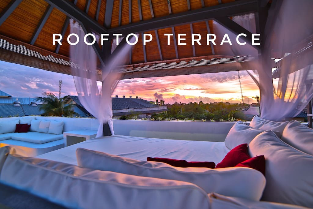 This private rooftop terrace has a large L shaped bench, a shaded gazebo, and a mini-fridge.. perfect for a BBQ or a romantic sunset session!