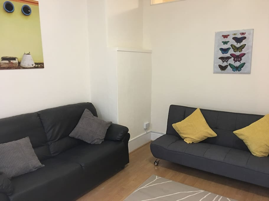 Living room with a 3 seater normal sofa