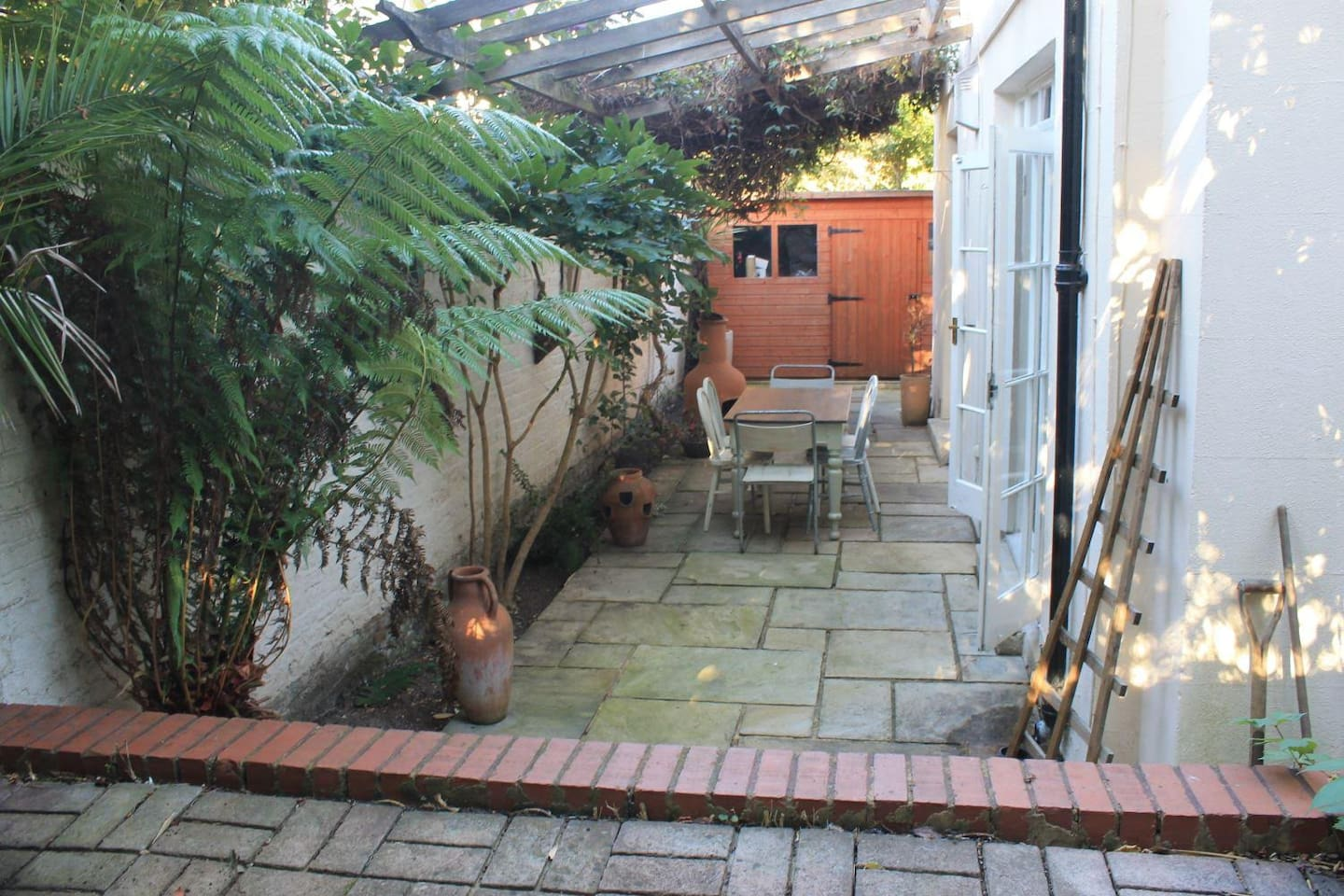 Private patio Garden with step up to cement mezzanine