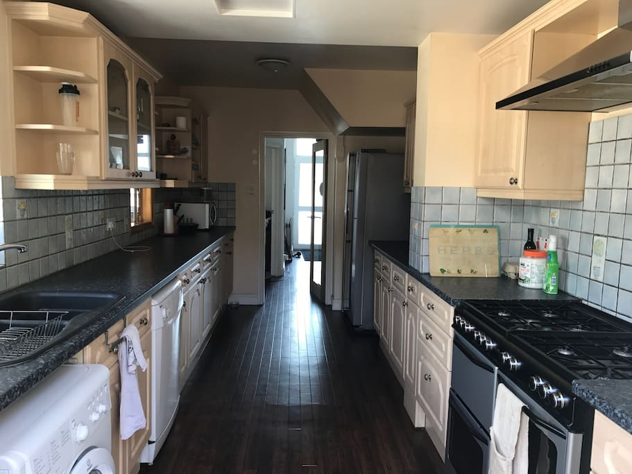 Fully loaded large spacious kitchen with American fridge that dispenses ice cubes and filtered water, 8 ring gas cooker, microwave, washing machine, dishwasher and freezer.