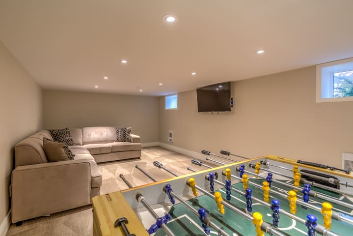 The basement has Netflix and Cable enabled TV, foosball, and a comfy sectional couch which also becomes a queen sized bed.