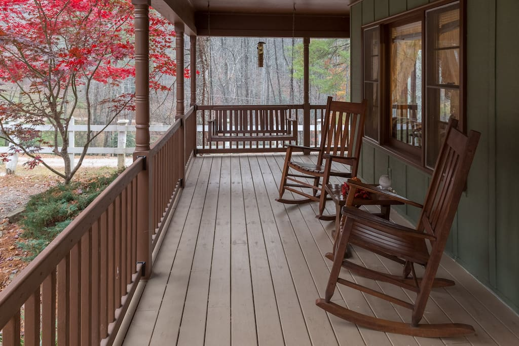 front porch with swing and rockers