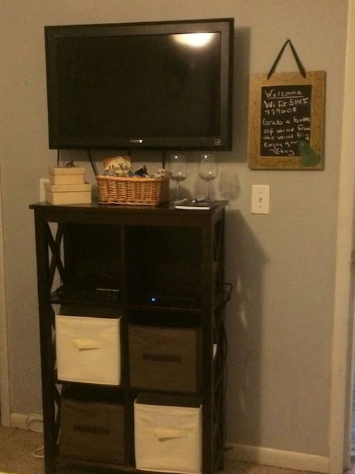 """32"""" TV with additional storage in bedroom"""