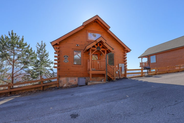 Stunning log cabin with private hot tub, shared pool, & soaring mountain views!
