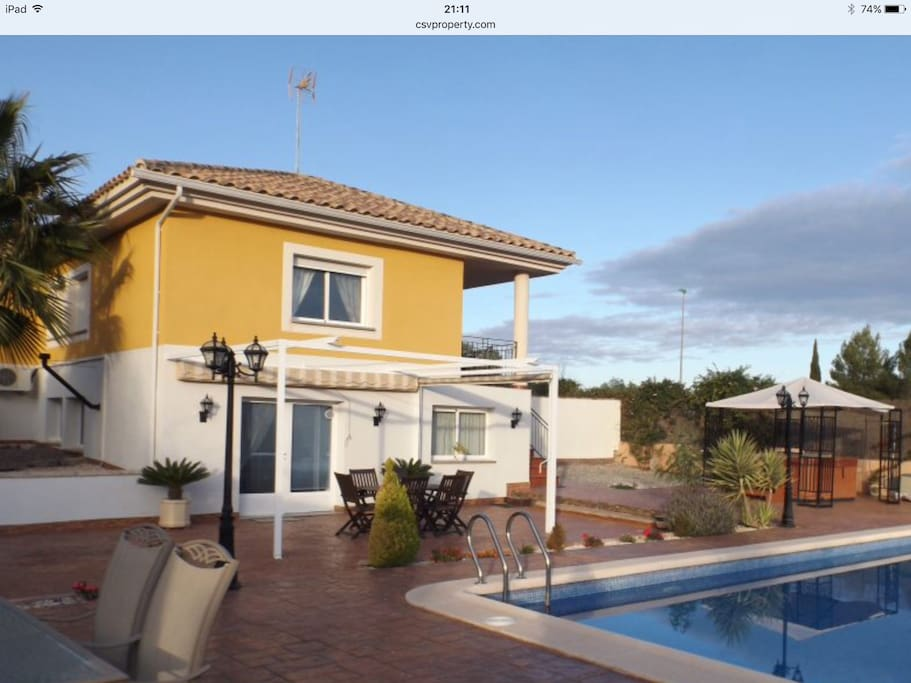 Private Garden, large pool, sun terraces and hot tub.