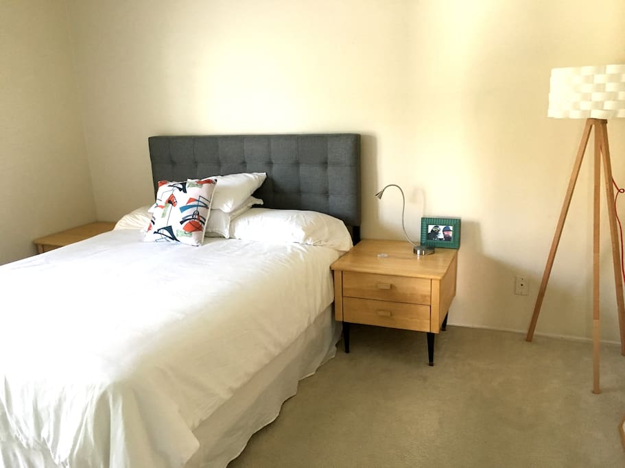 This is the bedroom with a queen bed