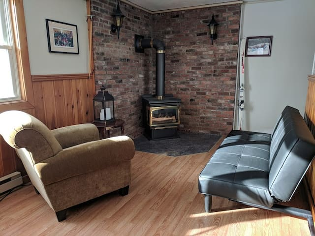 Common area with a propane fireplace
