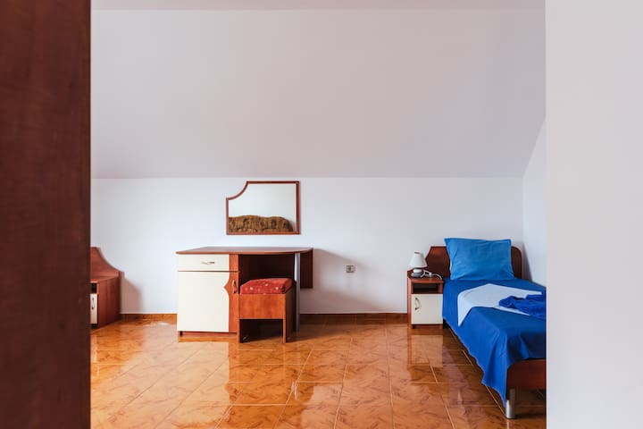 room on the 2nd floor with two 1.5 double beds and a sofa bed