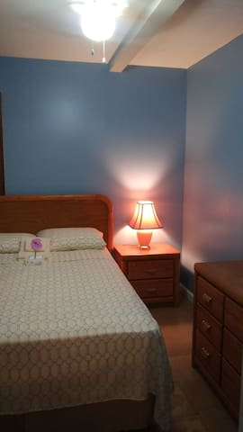 Nicely laid out Bedroom with Full Sized Bed, Night Stand, Clock Radio