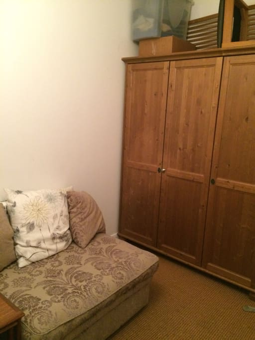 Wardrobe and sofa in the bedroom