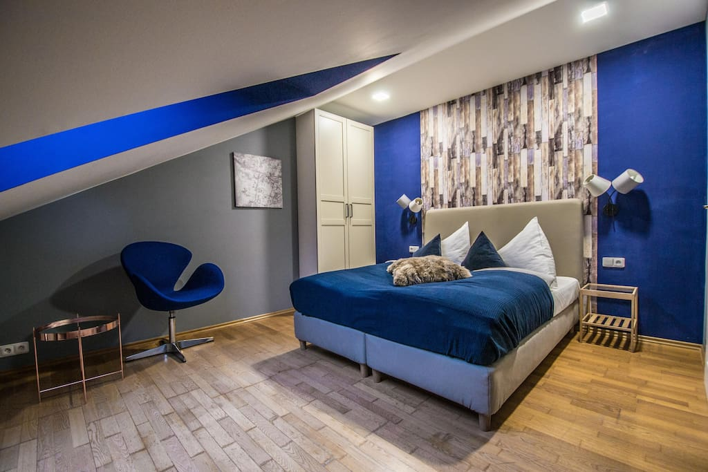 2nd bedroom with a queen bed, design chair and a huge wardrobe :)