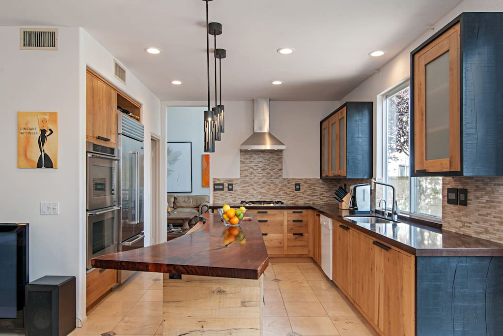 The kitchen is fully-equipped with stainless steel appliances