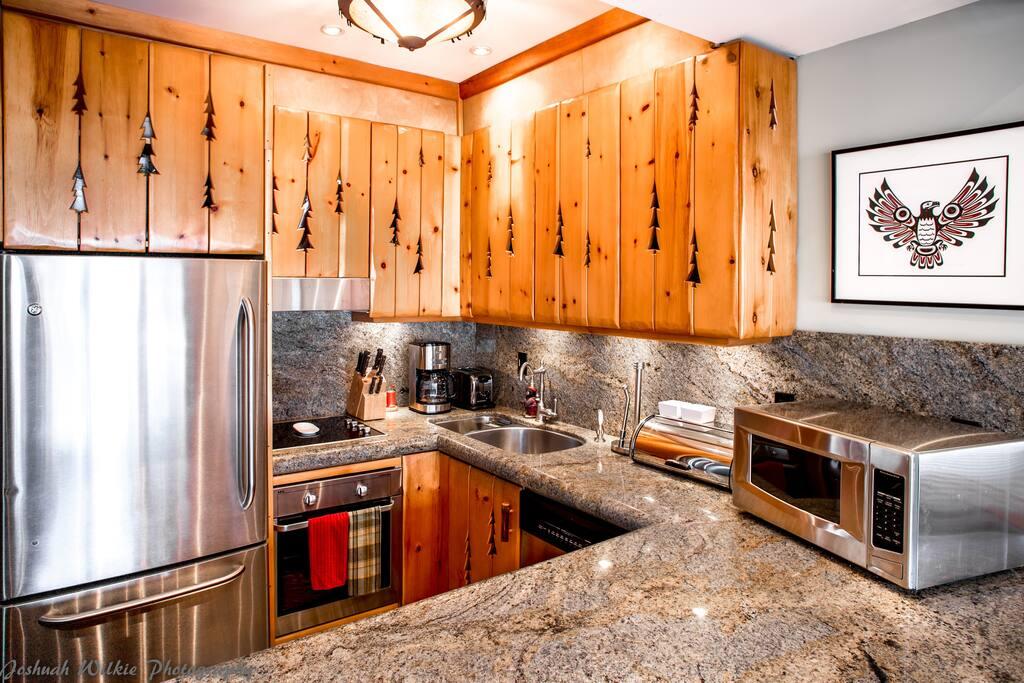 Modern updated kitchen, Stainless steel throughout, wine fridge, compactor garbage etc etc.