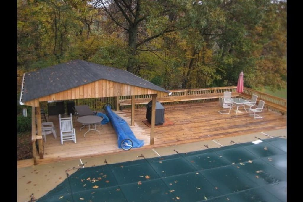 Large deck by pool.