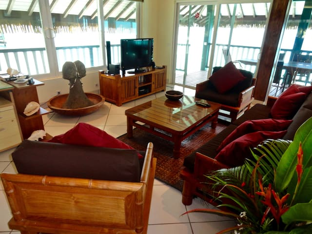 Fully air conditioned our Beautiful living room, with television and satellite, desk and high speed Wifi looks out at the lagoon from every window and sliding door.