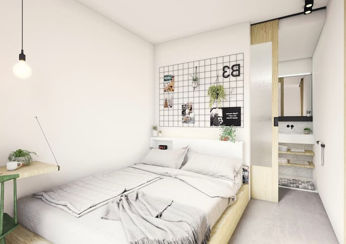 Cozy modern bedroom with adjacent bathroom (picture is an approximation of what the room will look like. Room is still being decorated at the moment)