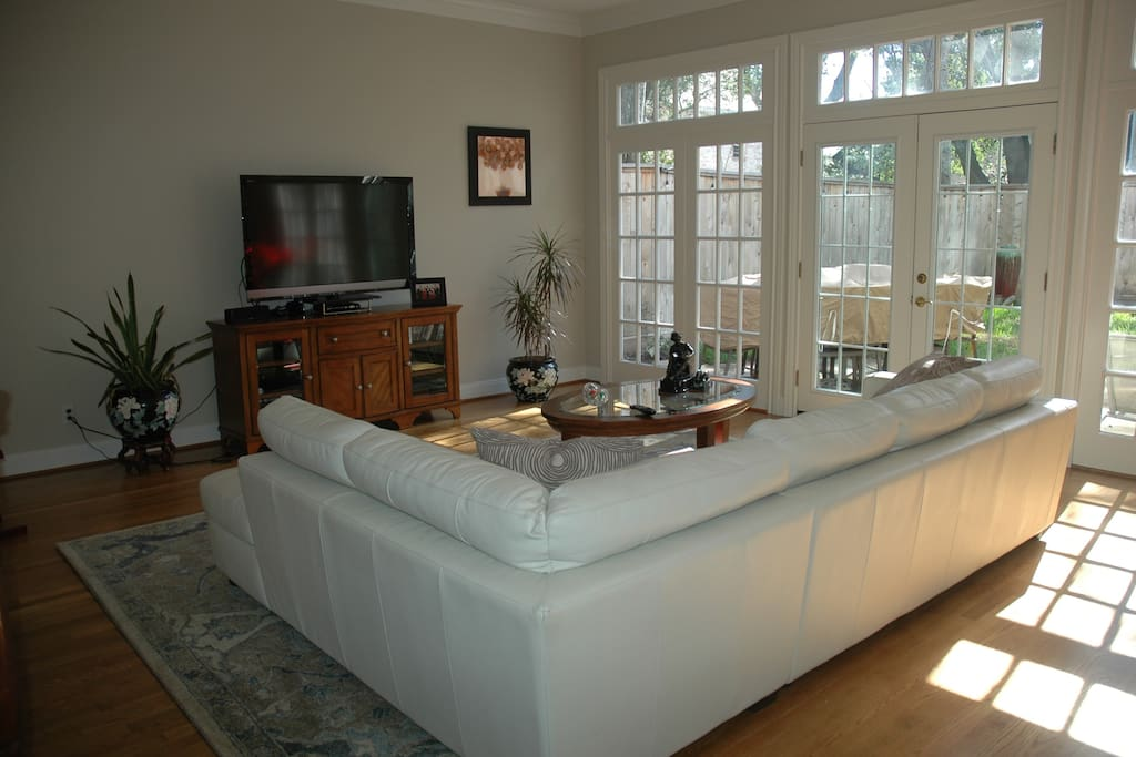Bright, with lots of windows and french doors that open to the patio