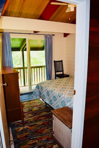 Bedroom with queen bed and walkout to covered porch