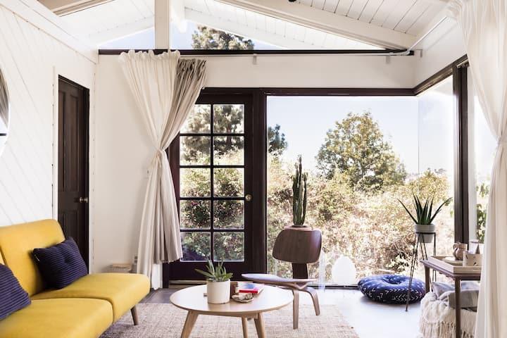 Unique Glass Hillside Studio with Stunning Views