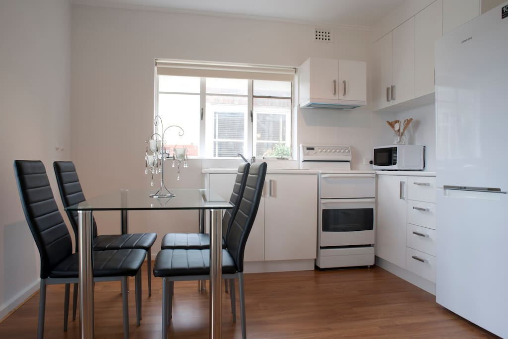 Fully functional spacious kitchen with electric cooktop, oven, fridge/freezer, microwave, toaster, coffee plunger, kettle, kitchen utensils, cutlery and dining space